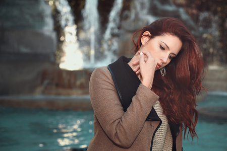 Beautiful red haired woman . Autumn emotional portrait Standard-Bild
