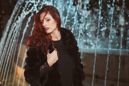 Red hair fashion model . Urban shot