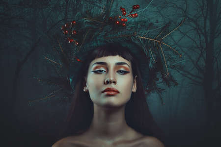 jule: Dark forest winter portrait of a beautiful woman. Fantasy and surreal