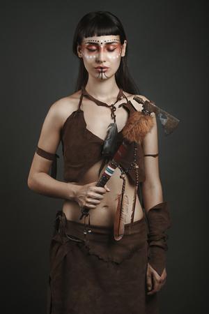 deadly: Native american female fighter posing . Studio shot