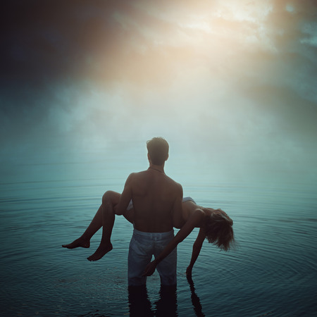 Man in ethereal water with dead lover. Dark romance  Stock Photo