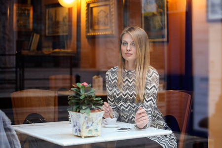 Beautiful elegant woman in an elegant city cafe. Urban lifestyle
