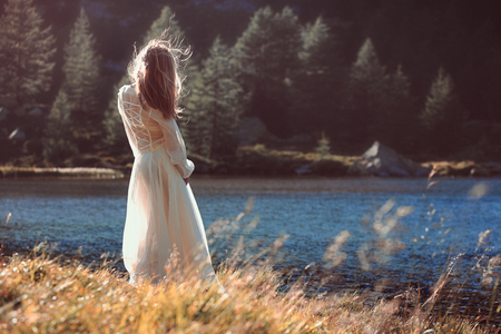 lonely person: Vintage romantic woman touched by last rays of the sun