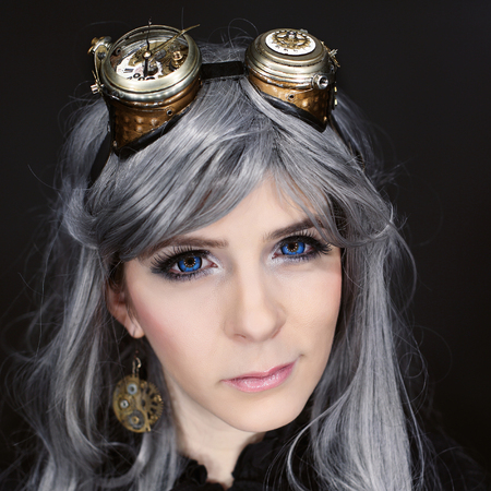 Beautiful woman portrait with steampunk glasses