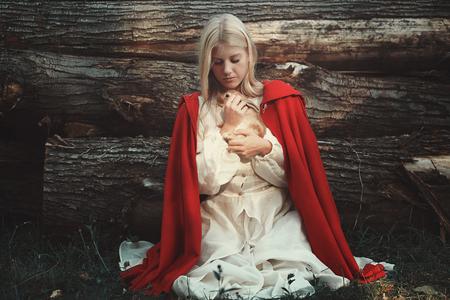 animal woman: Blond woman hugging little sweet rabbit. Animal protection Stock Photo