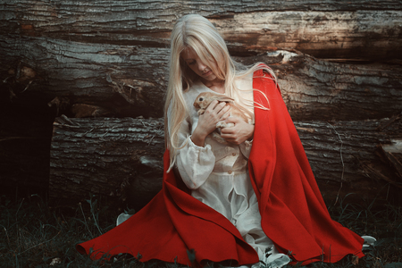 animal woman: Blond woman with her little rabbit. Animal friendship