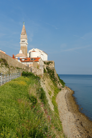 Piran church taken from the beach. Slovenian town