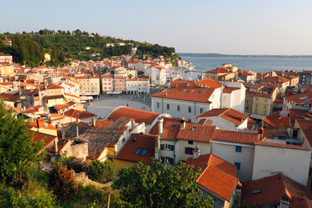 Beautiful Piran sea town in sunset light. Slovenian tourism Standard-Bild