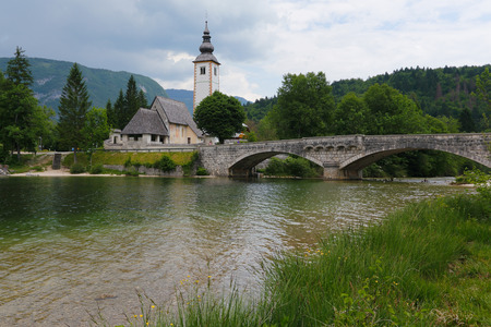 Bohinj lake and church in Triglav national park. Slovenia