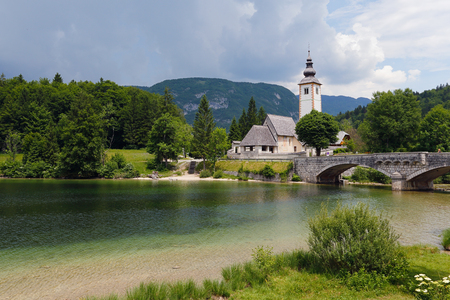 Beautiful church and bridge in Bohinj lake.Triglav national park