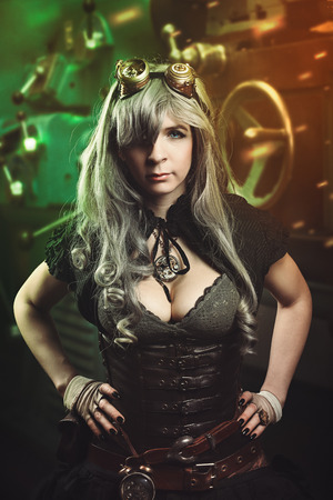 Beautiful steampunk woman in retro futuristic workshop