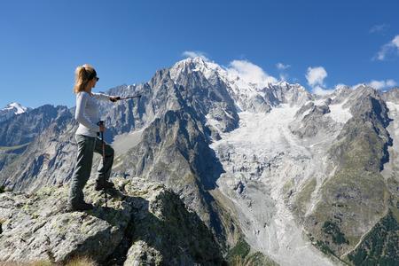 Hiker woman and Mont Blanc. Mont Chetif Courmayeur, Italy Standard-Bild