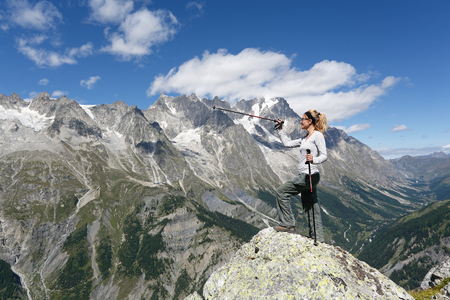 Hiker woman and mountain panorama. Mont Chetif Courmayeur, Italy
