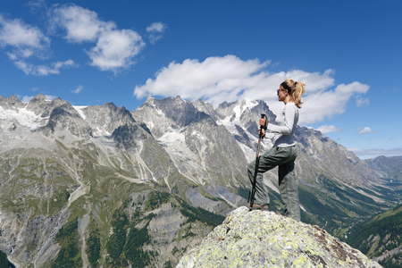 Hiker woman looking panorama. Giant's tooth Courmayeur, Italy