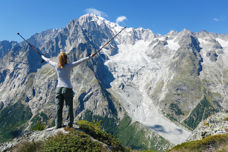 Happy hiker at mountain top. Mont Blanc Courmayeur, Italy Standard-Bild