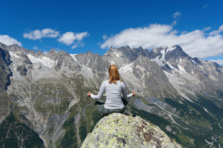 Yoga meditation in mountain top, Courmayeur, Italy