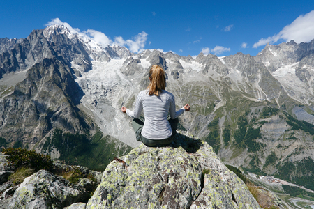 Yoga meditation in front of Mont Blanc, Courmayeur, Italy Standard-Bild