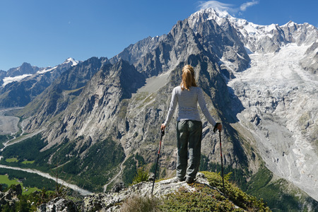 Hiker contemplates Mont Blanc. Courmayeur, Italy