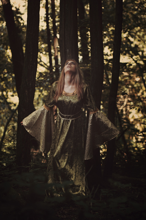 Fairy woman hearing the voice of the forest. Fantasy