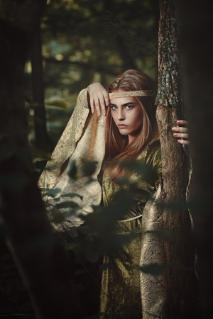 Fairytale woman with green dress. Fantasy and magic