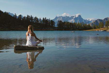 Woman practicing meditation and yoga Foto de archivo