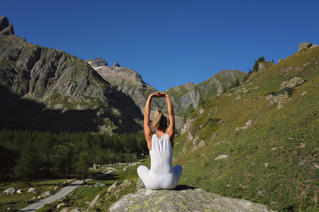 Woman stretching and yoga. Mountain backgroud