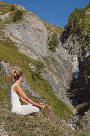 Young woman in yoga asana. Mountain peace