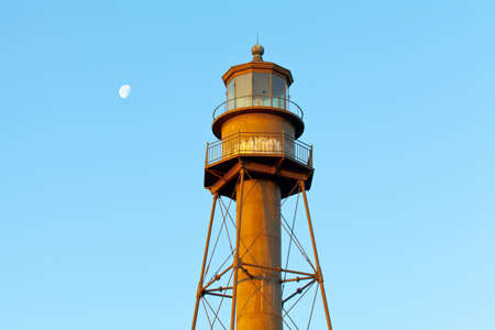 rustiness: Historic Lighthouse of Sanibel Island, Florida, with moon in the daytime