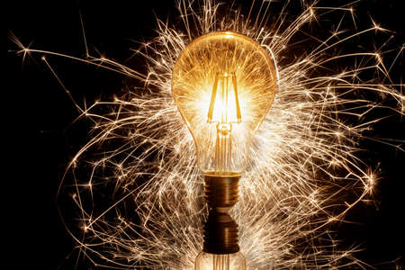 Spinning light bulb making attractive design in the night