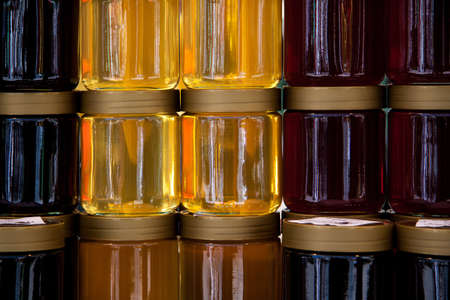 Sweet tasty delicious pure honey on glass jar