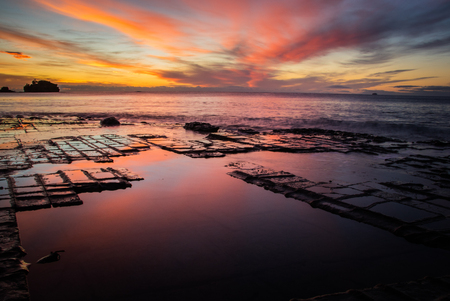 Vibrant sunrise over Tasmanias Tessellated Pavement