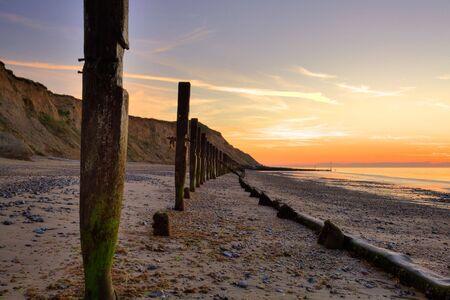 Breakwater on the beach in Norfolk in Great Britain