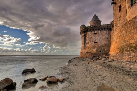 View on the atlantic ocean and church from the beach near Mont Saint-Michel abbey in Brittany, France Stock Photo - 7994896