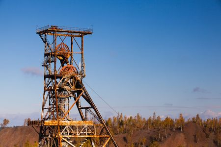 Old industry-Coal Mine and autumn forest 写真素材
