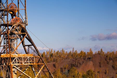 Old industry-Coal Mine and autumn forest Stock Photo
