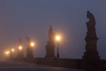 Famous Charles bridge in the mist photo