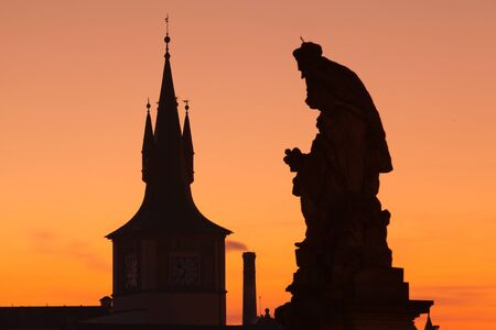 The statue and famous tower on Charles Bridge in Prague in Czech Republic photo