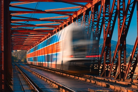 Abstract composition of moving train on the old railway bridge Stock Photo