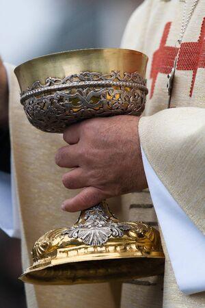 A close up of a pastor praying photo