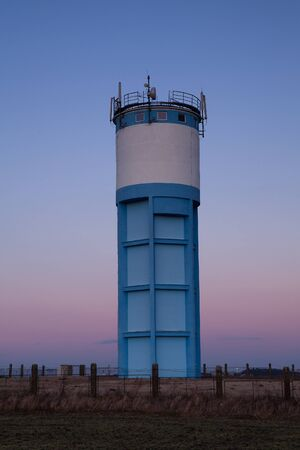 Historic water reservoir brick tower at sunset