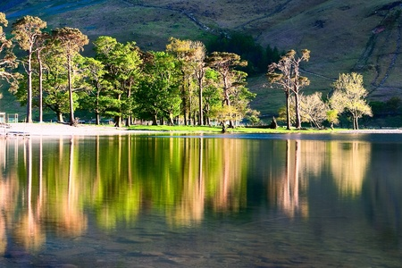 Reflection on the Buttermere Lake in Great Britain photo