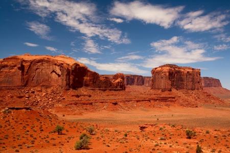 desert sunset: Peaks of rock formations in the Navajo Park of Monument Valley Utah