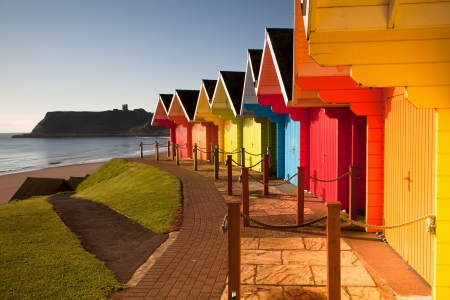 Beach huts at sunrise in Great Britain photo
