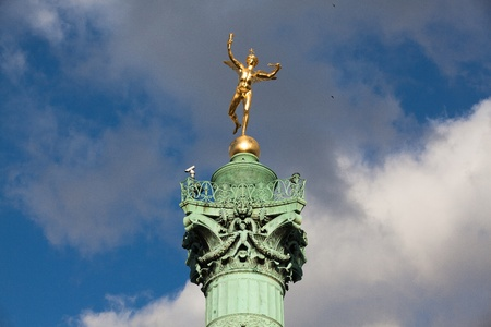 Gilded statue  Genie de la Liberte  at July Column  Place de la Bastille is a square in Paris, where the Bastille prison stood until the  Storming of the Bastille  during French Revolution  France  photo