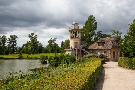 Part of the grounds near the Trianon, Versailles were chosen by Marie-Antoinette. In 1783, Richard Mique built this amusement village where the queen played at being a shepherdess. Stock Photo - 15945176