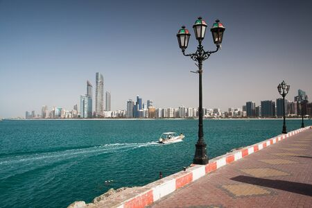 On the beach in modern arabic city Abu Dhabi