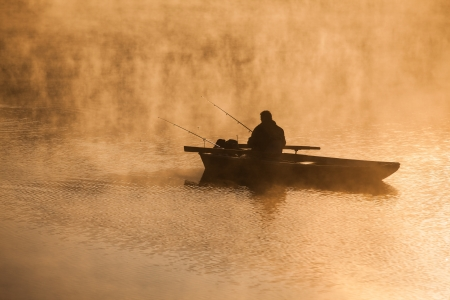 Fishing in the morning mist photo