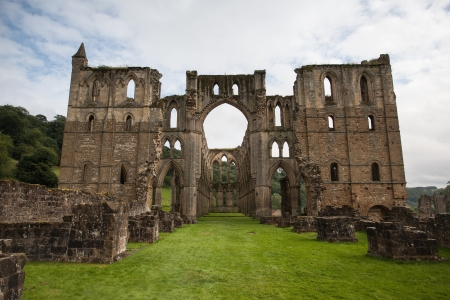 abbey ruins abbey: Scenic view of ruins of Rievaulx Abbey under cloudscape, North Yorkshire Moors, National Park, England