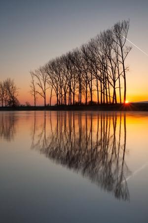 Symmetry reflection on the autumn river photo