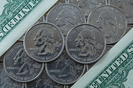 A lot of US quarter dollar coins photo